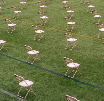 Empty field with chairs.